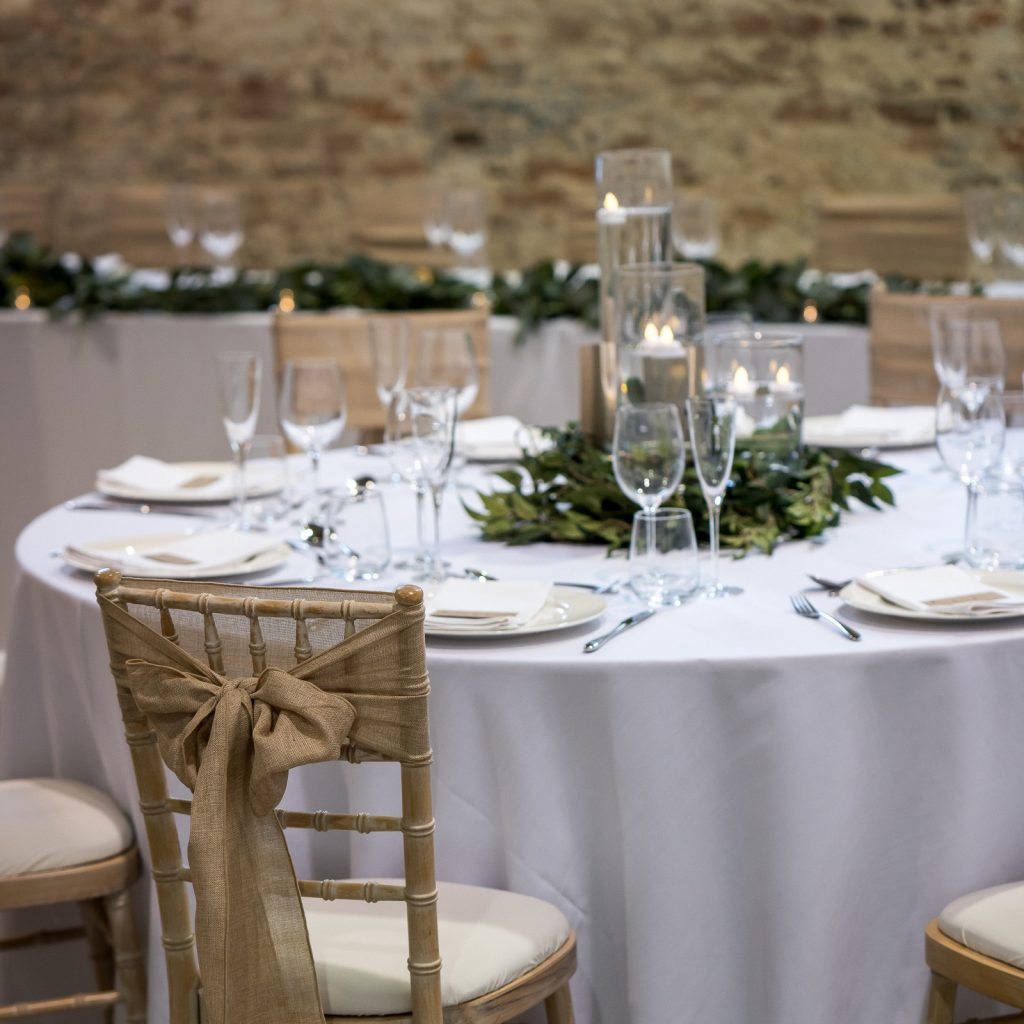 Rustic tables with candle centrepiece