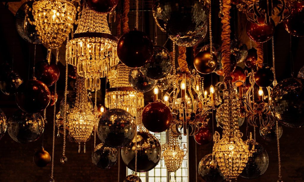 Stunning chandelier, crystal droplets, orbs and disco balls suspended from oak beams