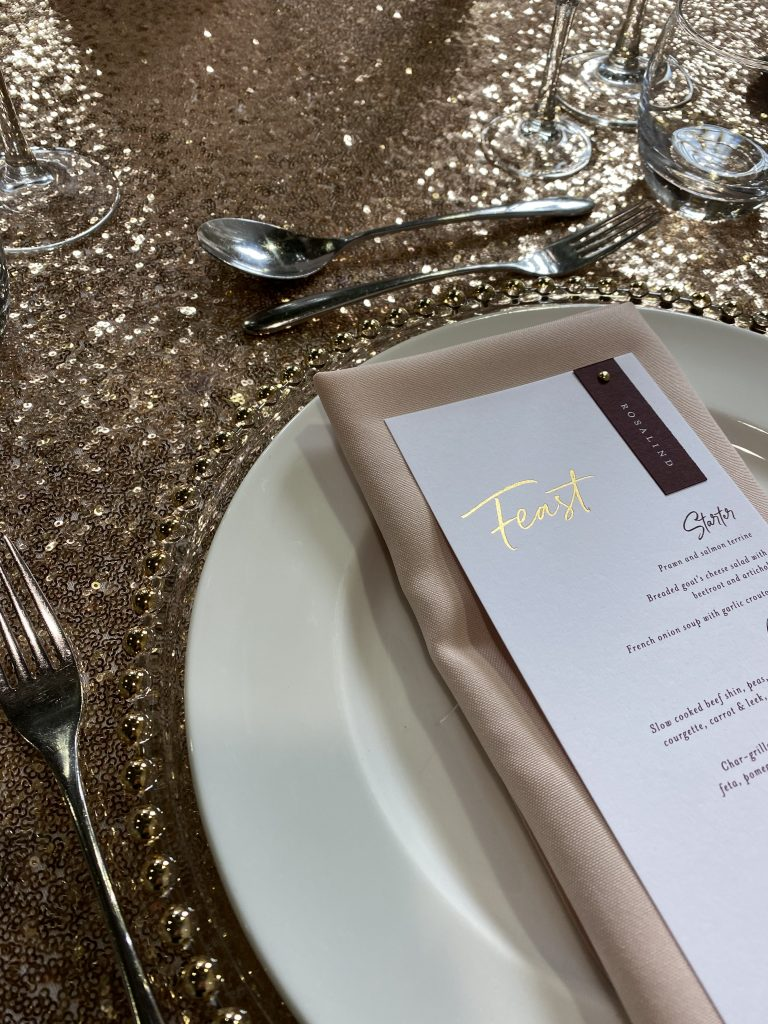 Blush sequin cloth with complimentary linen napkin and menu