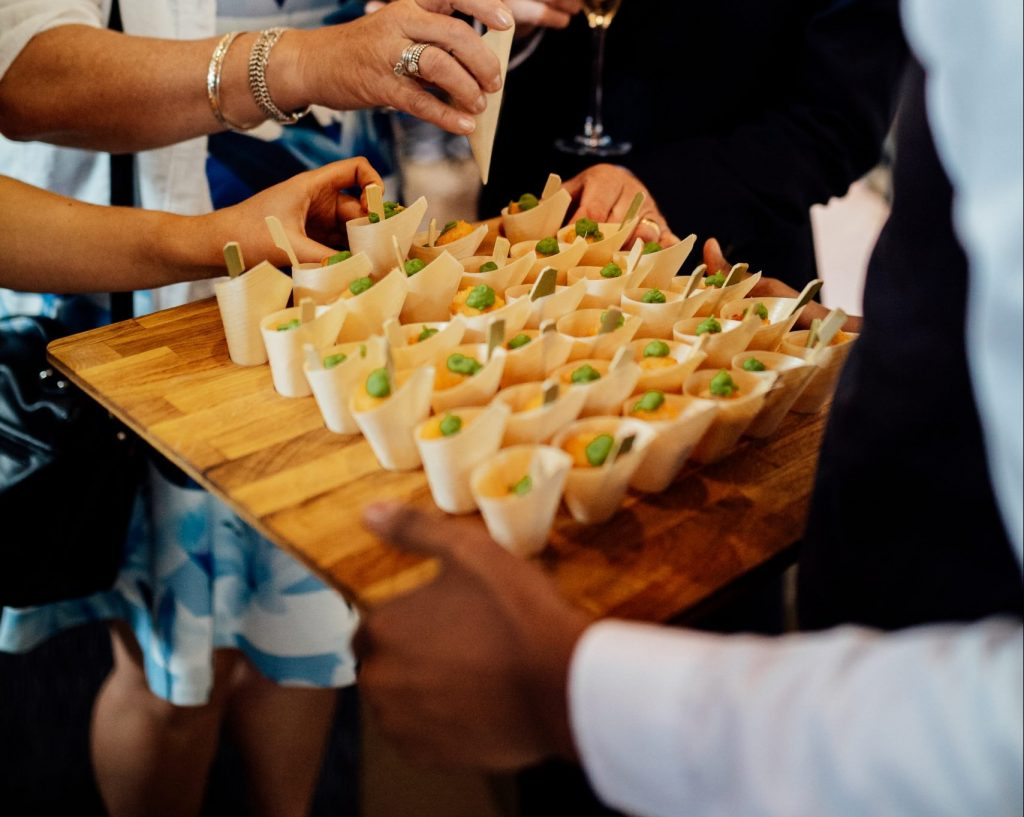 Guests eating fish and chip canapes