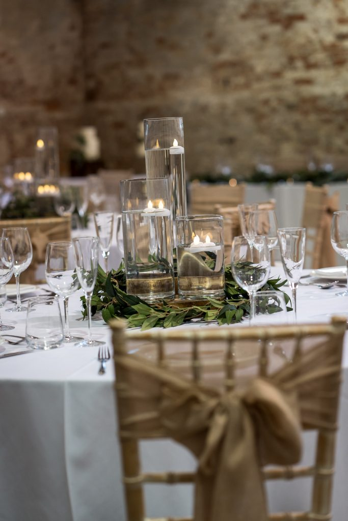 Floating candle cluster with white linen and hessian